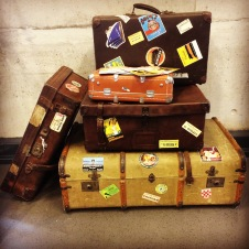Image from Changing Pages by Angela Vincent -- a pile of luggages for traveling, world travels | The Black Lion Journal | The Black Lion